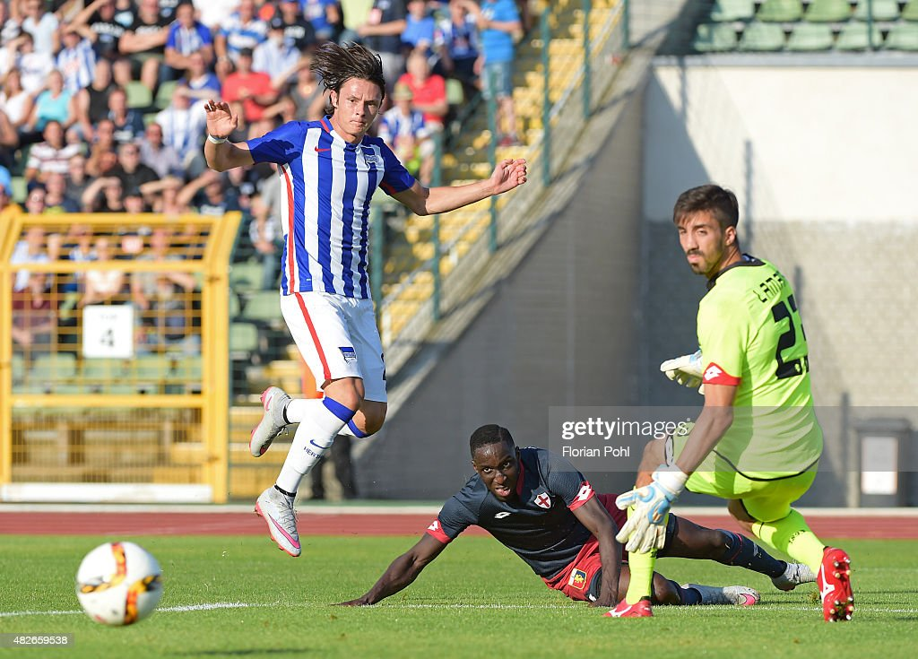 Nico Schulz of Hertha BSC passes the ball against Issa Cissokho and Eugenio Lamanna of CFC Genua during the game between Hertha BSC and CFC Genua on august 1, 2015 in Berlin, Germany.