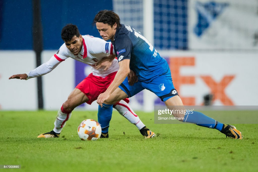 Nico Schulz of Hoffenheim is challenged by Danilo of Braga during the UEFA Europa League Group C match between 1899 Hoffenheim and Sporting Braga at Wirsol Rhein-Neckar-Arena on September 14, 2017 in Sinsheim, Germany.