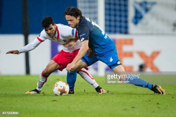Nico Schulz of Hoffenheim is challenged by Danilo of Braga during the UEFA Europa League Group C match between 1899 Hoffenheim and Sporting Braga at...