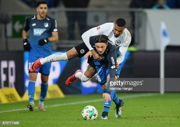 Nico Schulz of Hoffenheim is challenged by KevinPrince Boateng of Frankfurt during the Bundesliga match between TSG 1899 Hoffenheim and Eintracht...