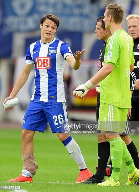 Nico Schulz talks to Bernd Leno during the Bundesliga match between Bayer 04 Leverkusen and Hertha BSC on August 30 2014 in Leverkusen Germany
