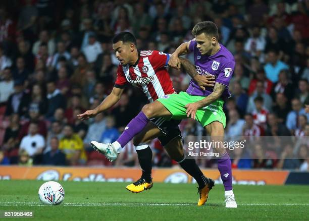 Nico Yennaris of Brentford and Jamie Paterson of Bristol City in action during the Sky Bet Championship match between Brentford and Bristol City at...