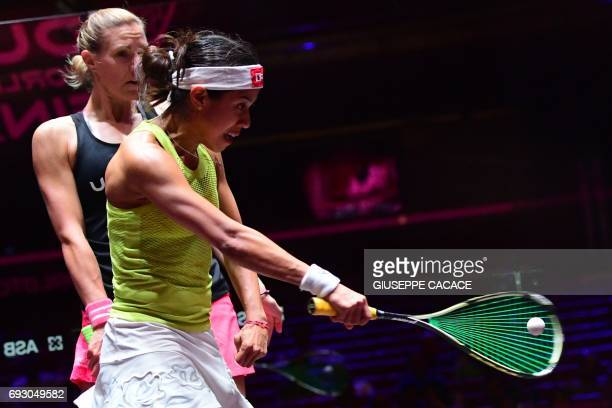 Nicol David of Malaysia competes against Laura Massaro of England during the first day of the PSA Dubai World Series Finals 2017 at Dubai Opera on...