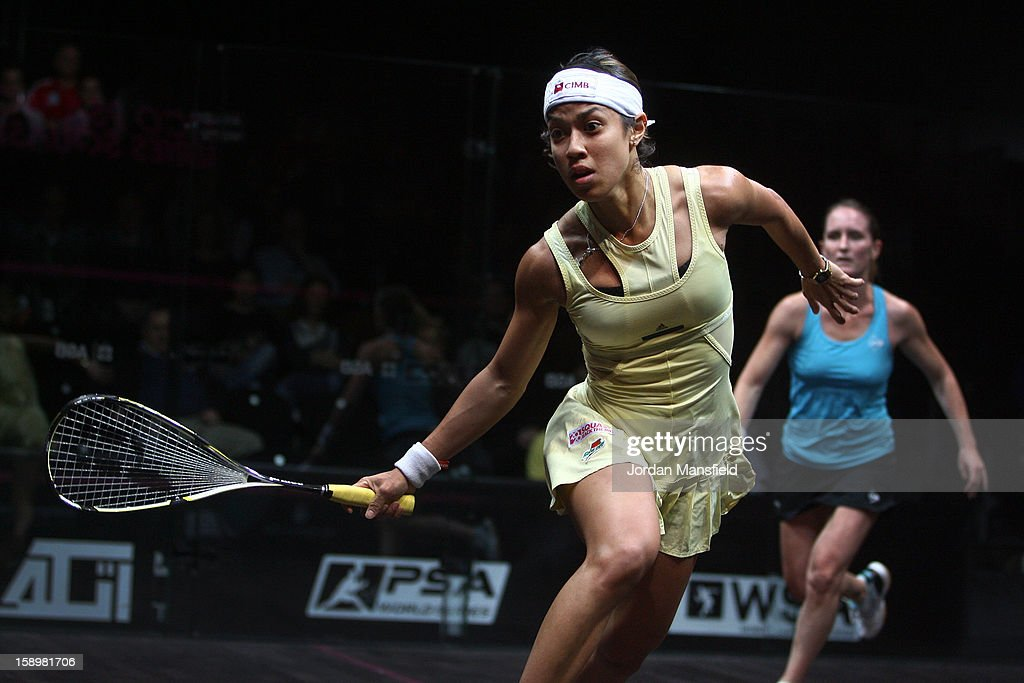 Nicol David of Malaysia in action against Natalie Grinham of the Netherlands during Day 3 of the World Series Finals helf at Queens Club on January 4, 2013 in London, England.