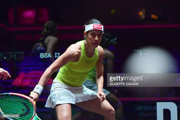 Nicol David of Malaysia plays against Laura Massaro of England during the first day of the PSA Dubai World Series Finals 2017 at Dubai Opera on June...