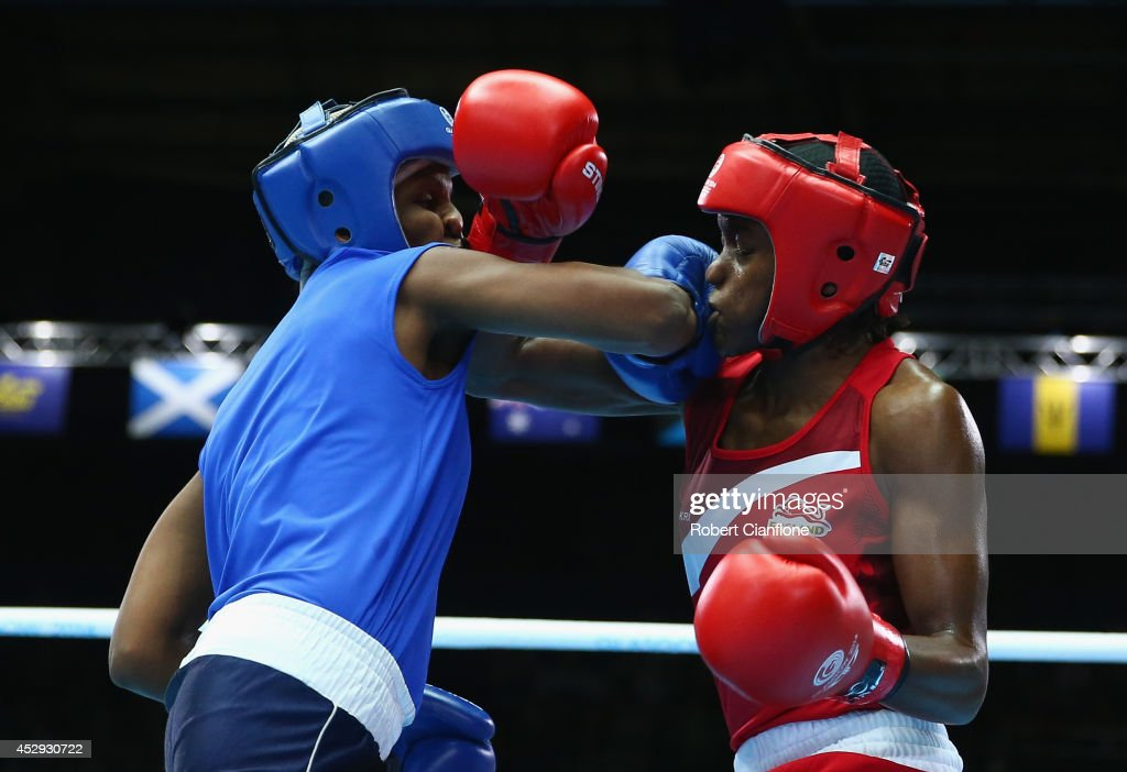 Nicola Adams of England competes with Erandi de Silva of Sri Lanka in the Women's Fly 4851kg Division Boxing quarterfinals at Scottish Exhibition And...