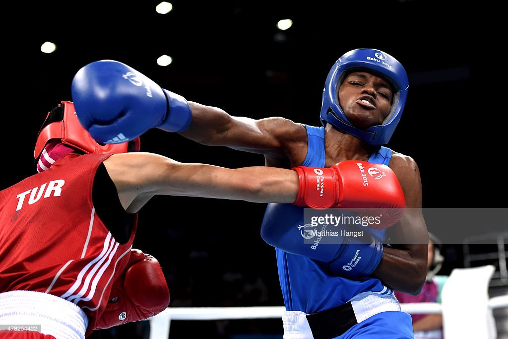Nicola Adams of Great Britain (blue) and Elif Coskun of Turkey (red) compete in the Women's Boxing Flyweight (48-51kg) Semi Final during day twelve of the Baku 2015 European Games at the Crystal Hall on June 24, 2015 in Baku, Azerbaijan.