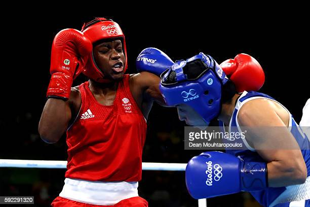 Nicola Adams of Great Britain and Sarah Ourahmoune of France slig it out during the Women's Fly Final Bout on Day 15 of the Rio 2016 Olympic Games at...