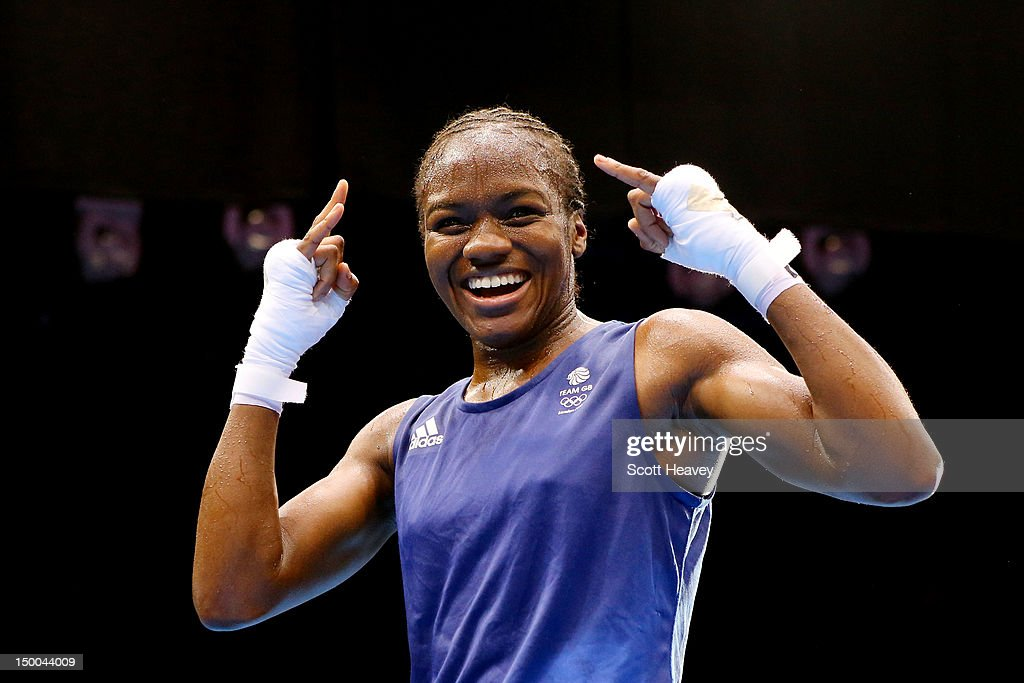 <a gi-track='captionPersonalityLinkClicked' href=/galleries/search?phrase=Nicola+Adams&family=editorial&specificpeople=9403811 ng-click='$event.stopPropagation()'>Nicola Adams</a> of Great Britain celebrates winning her bout against Cancan Ren of China during the Women's Fly (51kg) Boxing final bout on Day 13 of the London 2012 Olympic Games at ExCeL on August 9, 2012 in London, England.