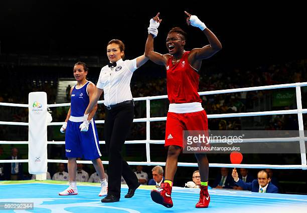 Nicola Adams of Great Britain celebrates winning the gold during the Women's Fly Final Bout against Sarah Ourahmoune of France on Day 15 of the Rio...
