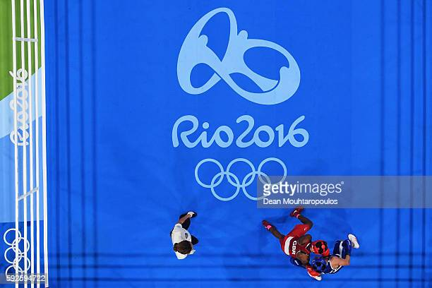 Nicola Adams of Great Britain competes on her way to winning the gold during the Women's Fly Final Bout against Sarah Ourahmoune of France on Day 15...