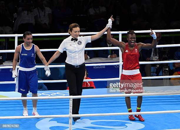 Nicola Adams of Great Britain is declared the winner after the Women's Fly Final Bout against Sarah Ourahmoune of France on Day 15 of the Rio 2016...