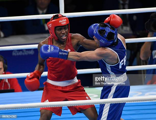 Nicola Adams of Great Britain lands a blow during the Women's Fly Final Bout against Sarah Ourahmoune of France on Day 15 of the Rio 2016 Olympic...