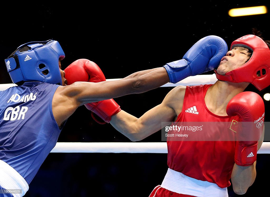 Nicola Adams (L) of Great Britain punches Cancan Ren (R) of China during the Women's Fly (51kg) Boxing final bout on Day 13 of the London 2012 Olympic Games at ExCeL on August 9, 2012 in London, England.