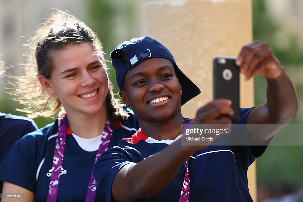 Nicola Adams of Great Britain takes a 'selfie' alongside team mate Savannah Marshall during the arrival of the torch for the athletes welcome...