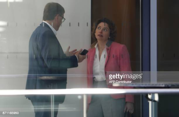 Nicola Beer secretary general of the free democratic FDP party talks with an unidentified man prior to the continuation of further exploratory talks...