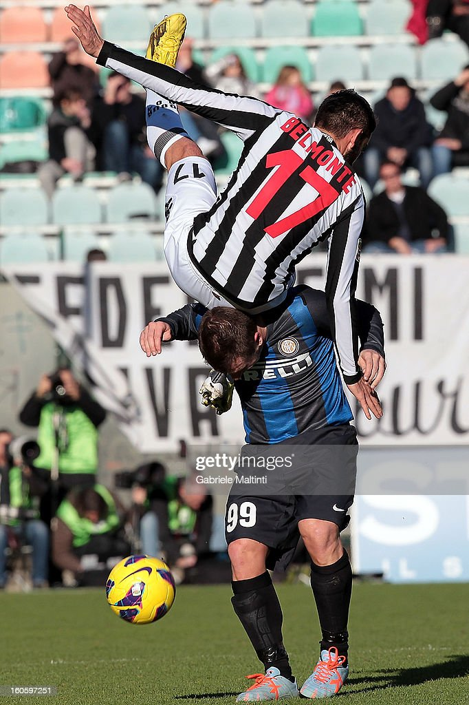 Nicola Belmonte of AC Siena fights for the ball with <a gi-track='captionPersonalityLinkClicked' href=/galleries/search?phrase=Antonio+Cassano&family=editorial&specificpeople=214558 ng-click='$event.stopPropagation()'>Antonio Cassano</a> of FC Internazionale Milano during the Serie A match between AC Siena and FC Internazionale Milano at Stadio Artemio Franchi on February 3, 2013 in Siena, Italy.