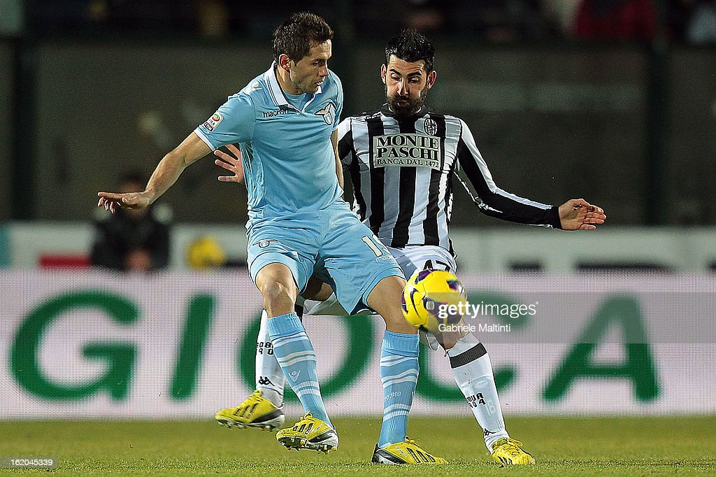 Nicola Belmonte of AC Siena fights for the ball with Senad Lulic of SS Lazio during the Serie A match between AC Siena and S.S. Lazio at Stadio Artemio Franchi on February 18, 2013 in Siena, Italy.