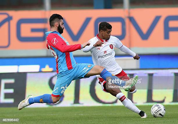 Nicola Belmonte of Catania competes for the ball with Fabinho of Perugia during the Serie B match between Calcio Catania and AC Perugia at Stadio...