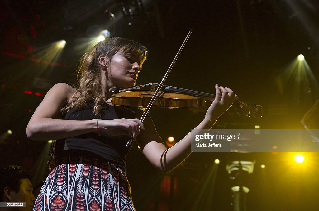 <a gi-track='captionPersonalityLinkClicked' href=/galleries/search?phrase=Nicola+Benedetti&family=editorial&specificpeople=240146 ng-click='$event.stopPropagation()'>Nicola Benedetti</a> performs on stage for iTunes Festival at The Roundhouse on September 28, 2014 in London, United Kingdom.