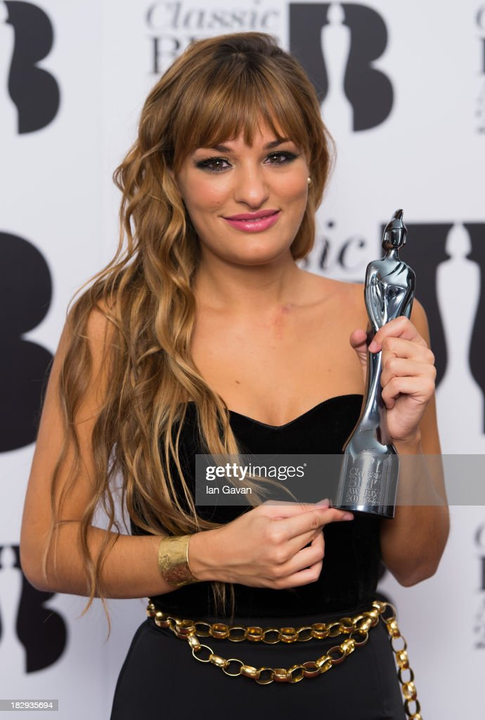 <a gi-track='captionPersonalityLinkClicked' href=/galleries/search?phrase=Nicola+Benedetti&family=editorial&specificpeople=240146 ng-click='$event.stopPropagation()'>Nicola Benedetti</a>, winner of Best Female Artist of the Year poses in the winners room at the Classic BRIT Awards 2013 at Royal Albert Hall on October 2, 2013 in London, England.