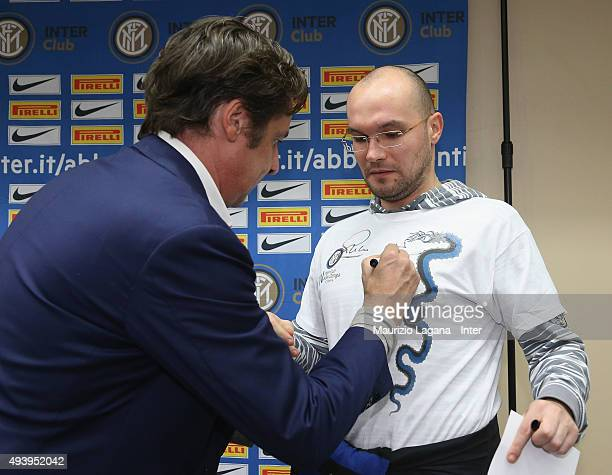 Nicola Berti of Inter sign an autograph during meeting between FC Internazionale Milano players and fans at Astoria Hotel on October 23 2015 in...