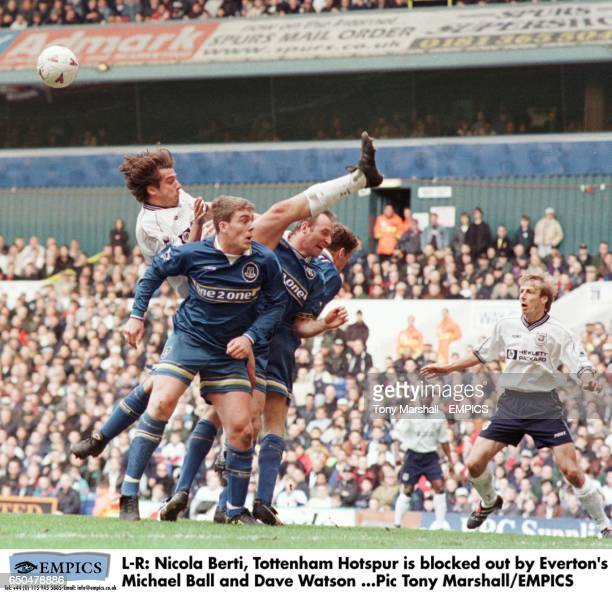 Nicola Berti Tottenham Hotspur is blocked out by Everton's Michael Ball and Dave Watson