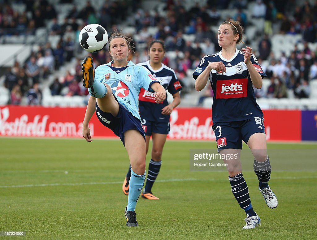 Nicola Bolger of Sydney FC gets to the ball ahead of Jessica Humble of the Victory during the round one W-League match between the Melbourne Victory and Sydney FC at Lakeside Stadium on November 10, 2013 in Melbourne, Australia.