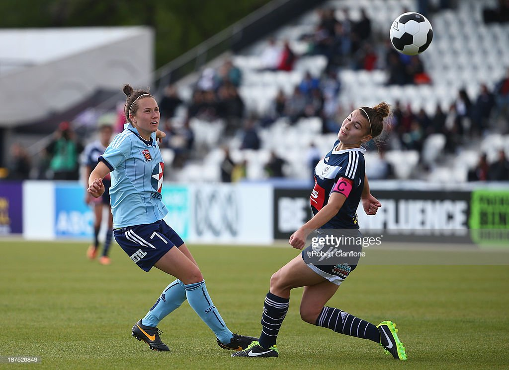 Nicola Bolger of Sydney FC kicks the ball past Stephanie Catley of the Victory during the round one W-League match between the Melbourne Victory and Sydney FC at Lakeside Stadium on November 10, 2013 in Melbourne, Australia.