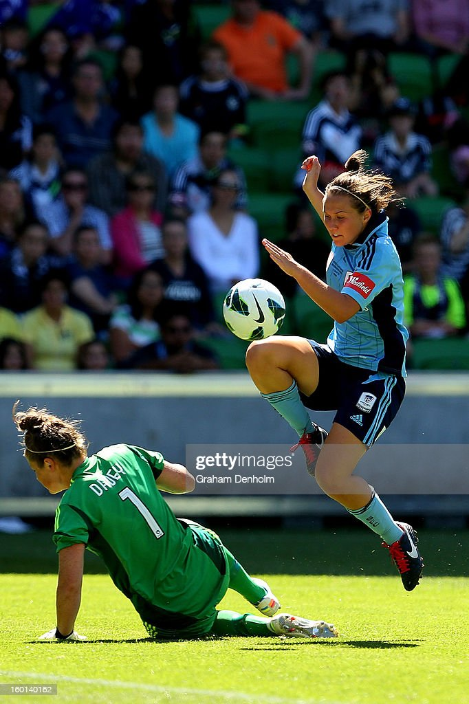 Nicola Bolger of Sydney FC (R) scores the first goal during the W-League Grand Final between the Melbourne Victory and Sydney FC at AAMI Park on January 27, 2013 in Melbourne, Australia.
