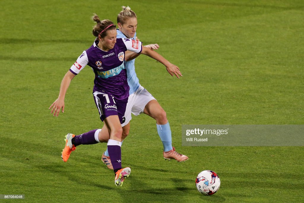 Nicola Bolger of the Glory and Jess Fishlock of Melbourne City compete for the ball during the round one W-League match between the Perth Glory and Melbourne City FC at nib Stadium on October 27, 2017 in Perth, Australia.