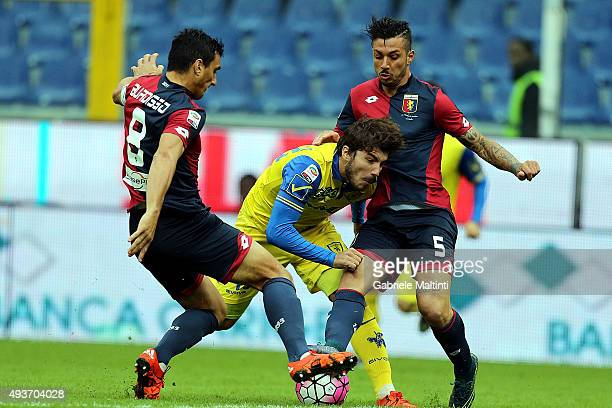 Nicola Burdisso and Armando Izzo of Genoa CFC in action against Alberto Paloschi of AC Chievo Verona during the Serie A match between Genoa CFC and...