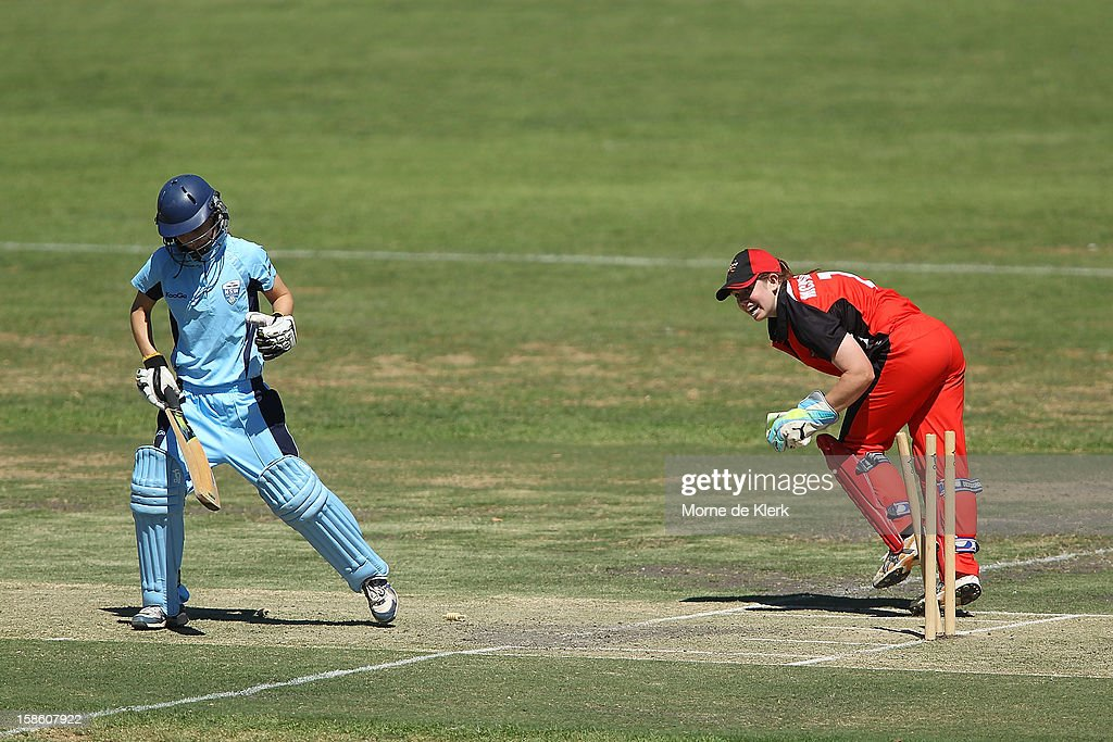 Nicola Carey (L) of the Breakers is stumped by Tegan McPharlin (R) of the Scorpions during the women's Twenty20 match between the South Australia Scorpions and the New South Wales Breakers at Prospect Oval on December 21, 2012 in Adelaide, Australia.
