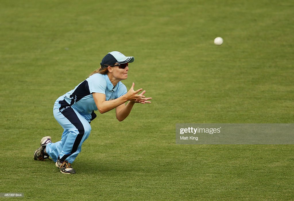 Nicola Carey of the Breakers takes a diving catch to dismiss <a gi-track='captionPersonalityLinkClicked' href=/galleries/search?phrase=Jess+Cameron+-+Cricketspeler&family=editorial&specificpeople=12709381 ng-click='$event.stopPropagation()'>Jess Cameron</a> of Victoria during the Women's Twenty20 final match between New South Wales and Victoria at Manuka Oval on January 28, 2015 in Canberra, Australia.