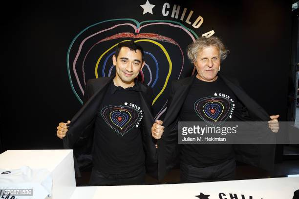 Nicola Formichetti and Renzo Rosso attend Fashion For Relief 'Child At Heart' cocktail party on April 20 2017 in Paris France The 'Child At Heart'...