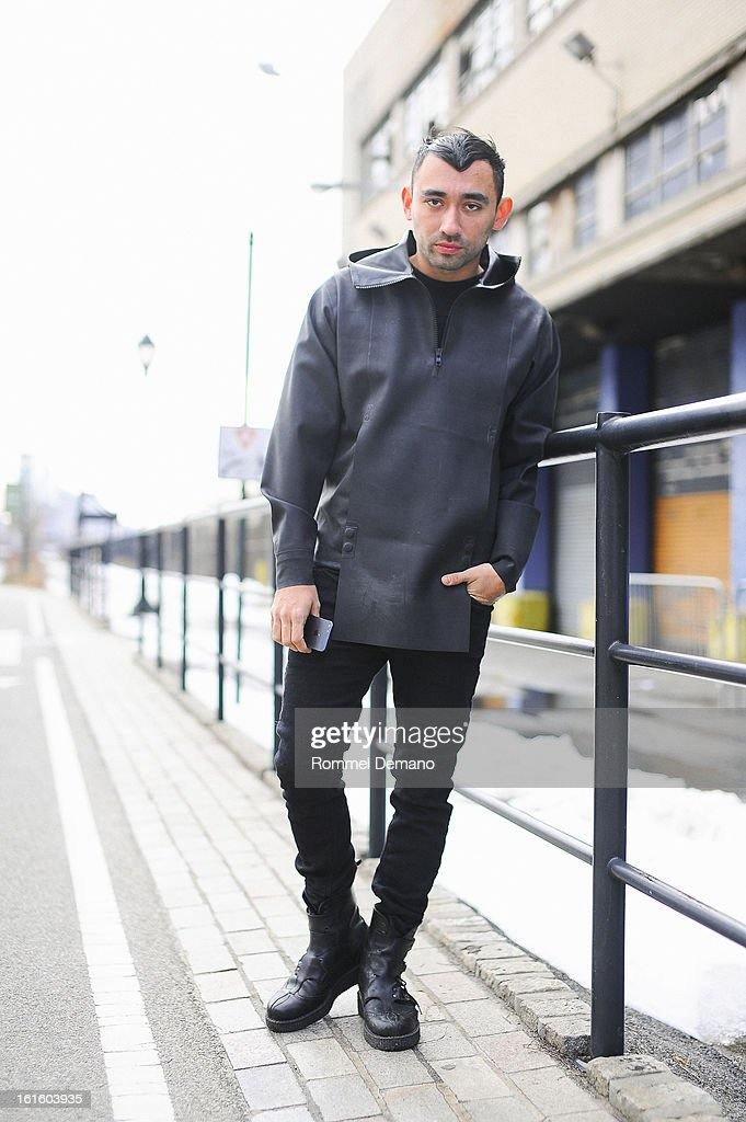 Nicola Formichetti, Fashion Director of Mugler, seen outside the Diesel Black Gold show wearing Mugler jacket, Diesel pants and Mugler shoes on February 12, 2013 in New York City.