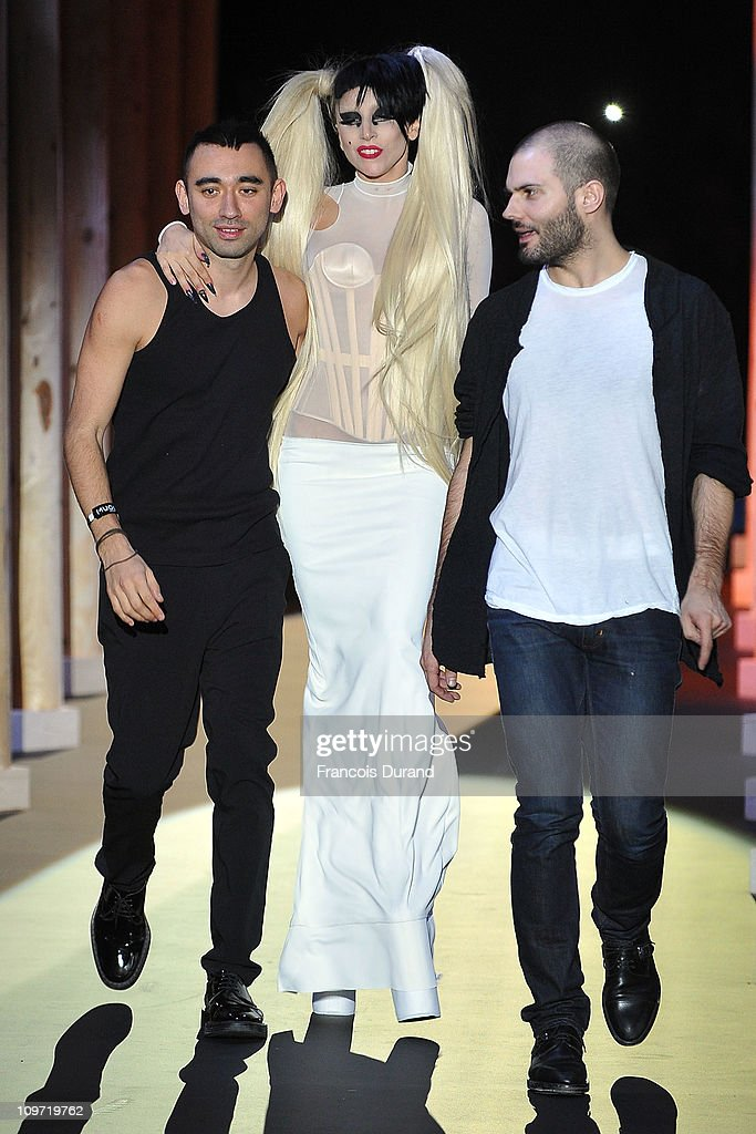 <a gi-track='captionPersonalityLinkClicked' href=/galleries/search?phrase=Nicola+Formichetti&family=editorial&specificpeople=7376980 ng-click='$event.stopPropagation()'>Nicola Formichetti</a>, <a gi-track='captionPersonalityLinkClicked' href=/galleries/search?phrase=Lady+Gaga&family=editorial&specificpeople=4456754 ng-click='$event.stopPropagation()'>Lady Gaga</a> and Sebastian Peigne walk the runway during the Thierry Mugler Ready to Wear Autumn/Winter 2011/2012 show during Paris Fashion Week at Gymnase Japy on March 2, 2011 in Paris, France.