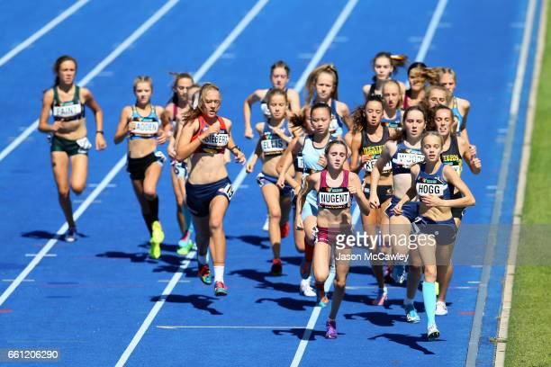 Nicola Hogg of Victoria leads the field in the womens under 15s 1500m final during day six of the Australian Athletics Championships at Sydney...