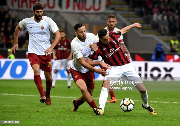 Nicola Kalinic of AC Milan is in action against Kostas Manolas of Roma during the Serie A 2017/18 match between AC Milan and AS Roma at Stadio...