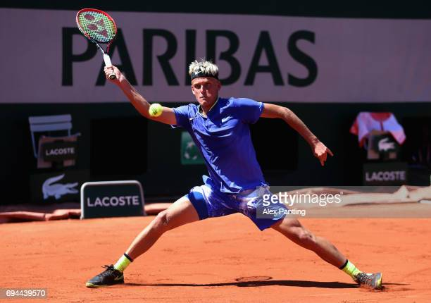 Nicola Kuhn of Spain plays a forehand during the boys singles final match against Alexei Popyrin of Australia on day fourteen of the 2017 French Open...