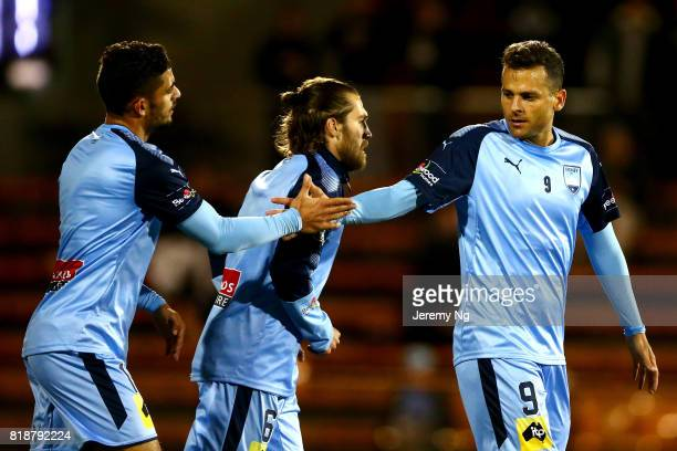 Nicola Kuleski Joshua Billante and Milos Ninkovic of Sydney FC celebrate a goal during the 2017 Johnny Warren Challenge match between Sydney FC and...