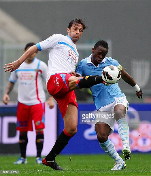 Nicola Legrottaglie of Calcio Catania competes for the ball with Louis Saha of SS Lazio during the Serie A match between SS Lazio and Calcio Catania...
