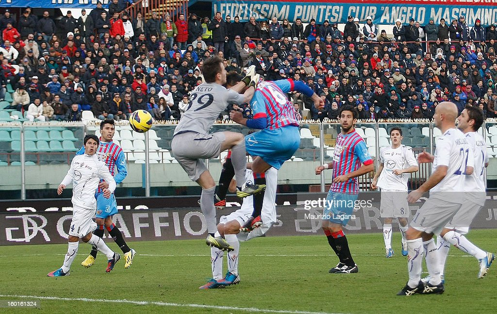 Nicola Legrottaglie of Catania scores his team's equalizing goal during the Serie A match between Calcio Catania and ACF Fiorentina at Stadio Angelo...