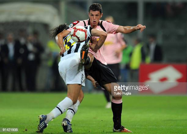 Nicola Legrottaglie of Juventus and Igor Budan of Palermo battle for the ball during the Serie A match played between US Citta di Palermo and...