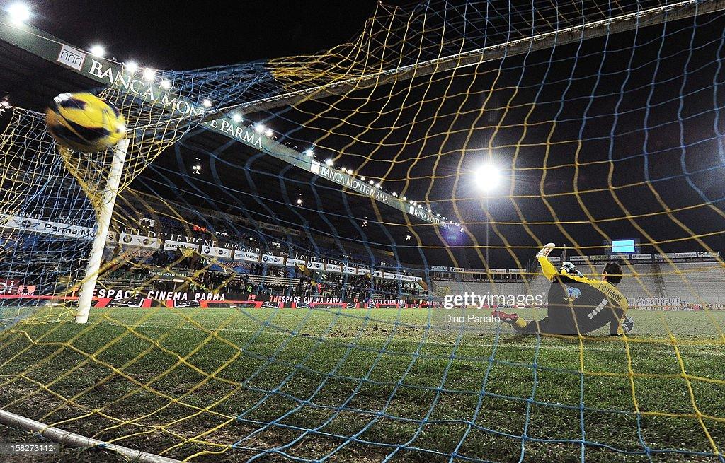 Nicola Pavarin (L) goalkeeper of Parma FC fails to save a penalty shot during the TIM Cup match between Parma FC and Catania Calcio at Stadio Ennio Tardini on December 12, 2012 in Parma, Italy.