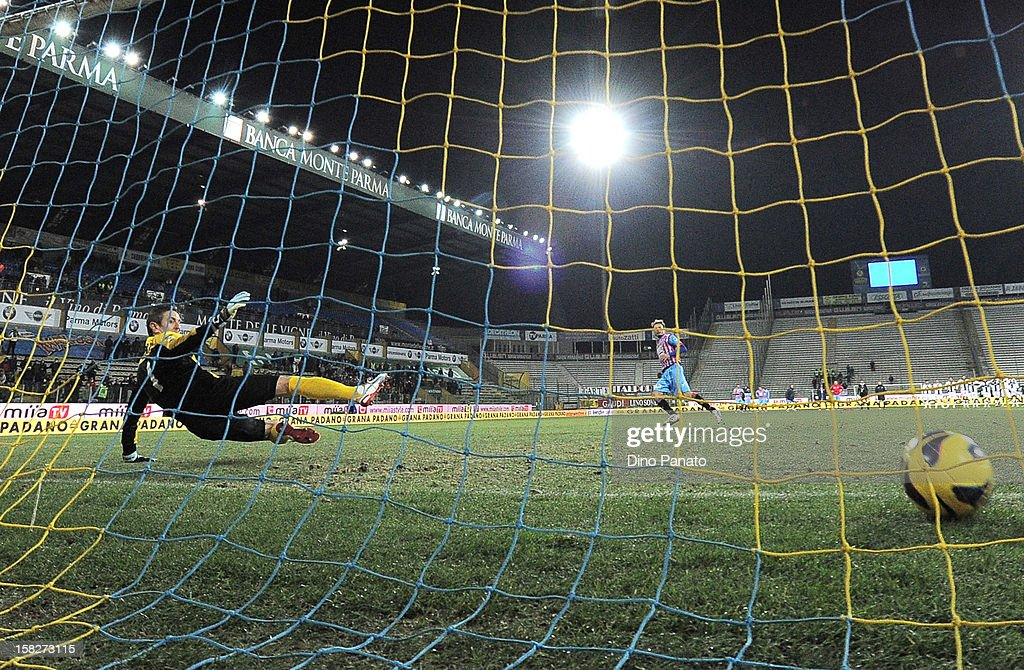 Nicola Pavarin (L) goalkeeper of Parma FC fails to save as Giovanni Marchese scores last penalty shot during the TIM Cup match between Parma FC and Catania Calcio at Stadio Ennio Tardini on December 12, 2012 in Parma, Italy.