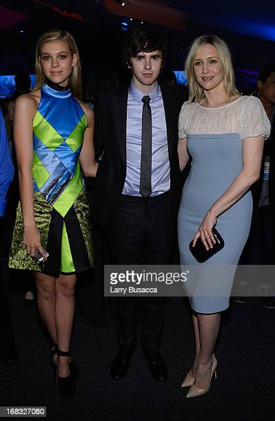 Nicola Peltz Freddie Highmore and Vera Farmiga attend the AE Networks 2013 Upfront on May 8 2013 in New York City