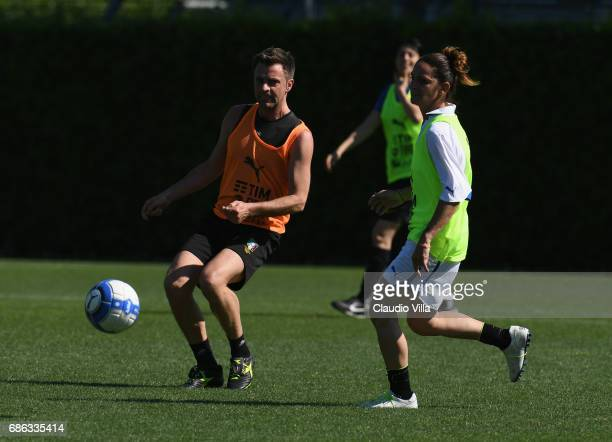 Nicola Rizzoli and Patrizia Panico compete for the ball during a friendly match during the Italian Football Federation Kick Off Seminar on May 21...