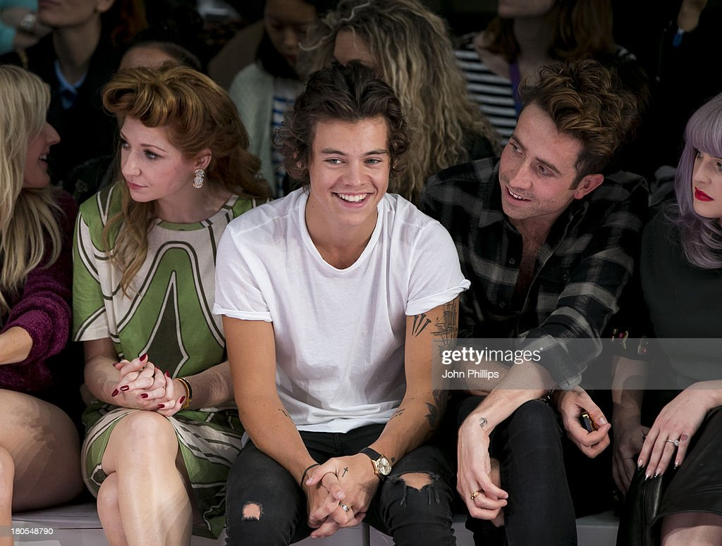 Nicola Roberts, Harry Styles and Nick Grimshaw attend the House Of Holland show during London Fashion Week SS14 on September 14, 2013 in London, England.