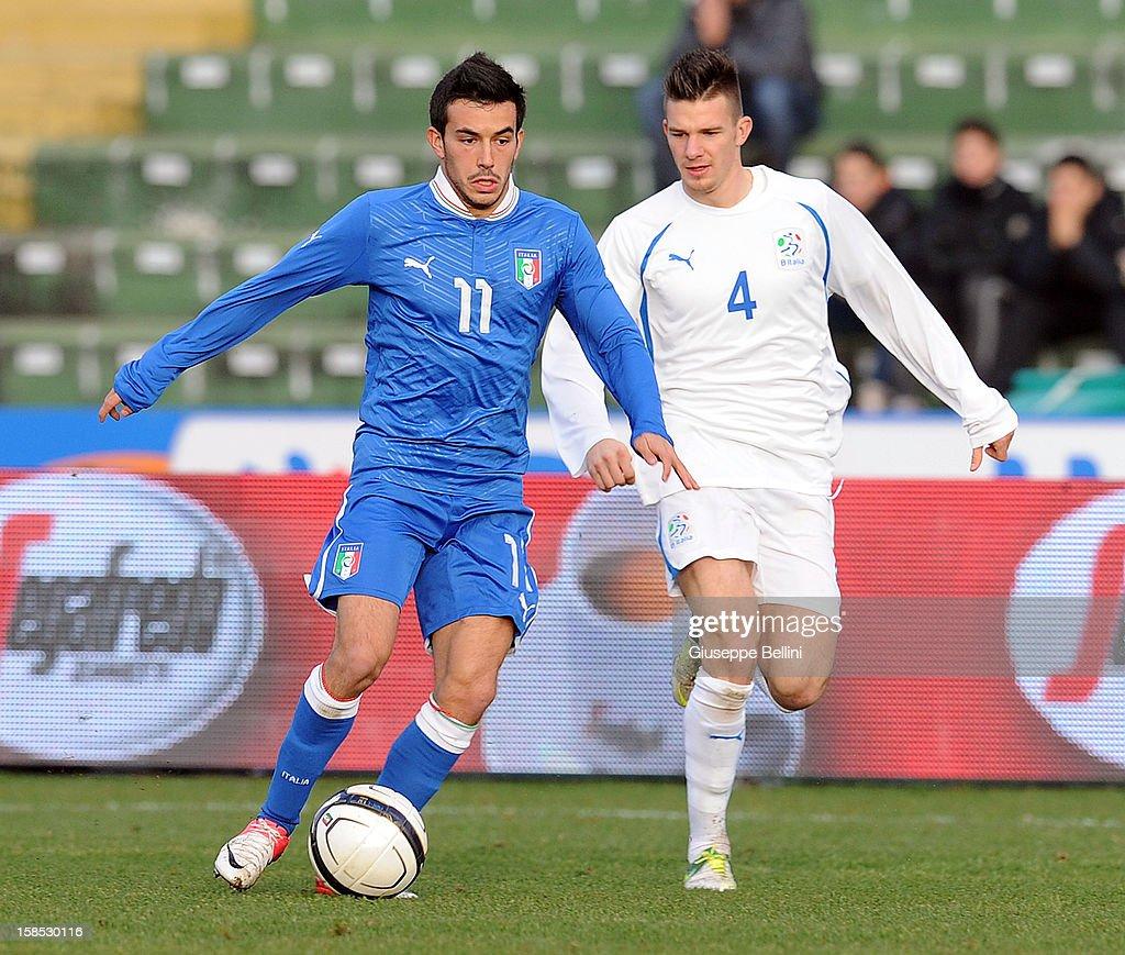 Nicola Sansone of Italy U21 and Riccardo Fiamozzi of Rappresentativa Serie B in action during the friendly match between Italy U21 and Rappresentativa Serie B at Stadio Libero Liberati on December 18, 2012 in Terni, Italy.